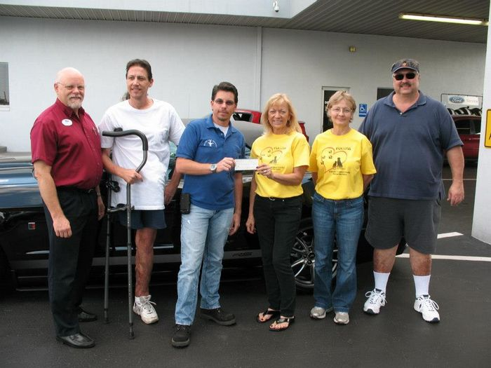 Nature Coast Mustangs $1000 charity donation to FOCCAS (Friends of Citrus County Animal Services)